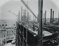 Construction work on the main central tower of the Chateau Frontenac designed by William Sutherland Maxwell, photograph, 1922, from the Archives of the Chateau Frontenac, Quebec City, Quebec, Canada. The Chateau Frontenac opened in 1893 and was designed by Bruce Price as a chateau style hotel for the Canadian Pacific Railway company or CPR. It was extended in 1924 by William Sutherland Maxwell. The building is now a hotel, the Fairmont Le Chateau Frontenac, and is listed as a National Historic Site of Canada. The Historic District of Old Quebec is listed as a UNESCO World Heritage Site. Copyright Archives Chateau Frontenac / Manuel Cohen