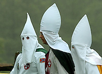 Hooded members of the World Order of the Ku Klux Klan arrive at the Gettysburg National Military Park for a protest rally Saturday, Sept. 2, 2006 in Gettysburg, Pa. The KKK fielded 25 members for the event and their were no incidents. (AP Photo/Bradley C Bower)