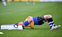David Wilson of Bath Rugby stretches during the pre-match warm-up. Aviva Premiership match, between Bath Rugby and Exeter Chiefs on October 17, 2015 at the Recreation Ground in Bath, England. Photo by: Patrick Khachfe / Onside Images
