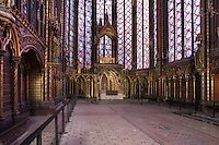 General view of the altar and the reliquary, built on the pattern of the chapel, Upper chapel of La Sainte-Chapelle ( (The Holy Chapel), 1248, Paris, France. La Sainte-Chapelle was commissioned by King Louis IX to house his collection of Passion Relics, including the Crown of Thorns. In the choir, the windows have only two lancets. The most famous features of the chapel are the great stained glass windows. Fifteen huge mid-13th century windows fill the nave and apse. Picture by Manuel Cohen