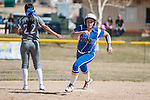 Western Nevada's Britni Greninger (22) runs past Salt Lake Community College's second baseman Karly Bunderson (22) the first game of a two game series in Carson City, Nev. on Saturday, March 7, 2015.<br />