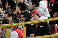 BOGOTÁ -COLOMBIA, 07-12-2016: Hinchas de Santa Fe lucen decepcionados durante el encuentro de ida entre Independiente Santa Fe y Atlético Nacional por la semifinal de la Liga Aguila II 2016 jugado en el estadio Nemesio Camacho El Campin de la ciudad de Bogota.  / Fans of Santa Fe look disappointed during the first leg match between Independiente Santa Fe and Independiente Medellin for the semifinal of the Liga Aguila II 2016 played at the Nemesio Camacho El Campin Stadium in Bogota city. Photo: VizzorImage/ Gabriel Aponte / Staff