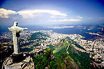 Rio de Janeiro, Brazil. Christ Statue, aerial shot with the Morro Dona Martha and Guanabara Bay behind. Corcovado mountain.