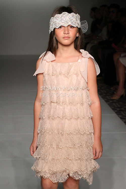 """Model walks runway in an outfit from the Jackie Tejada Spring Summer 2017 """"Little Miss Jackie Goes To New York"""" collection for the Emerging Designer's Spring 2017 fashion show on September 11, 2016; during Fashion Gallery New York Fashion Week Spring Summer 2017."""
