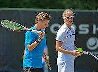 Netherlands, Rosmalen , June 11, 2015, Tennis, Topshelf Open, Autotron, Lady's doubles:  Ysaline Bonaventure (BEL) with her partner Demi Schuurs (NED) (L)<br /> Photo: Tennisimages/Henk Koster