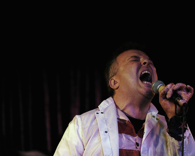Jello Biafra, singer from the punk band Dead Kennedys, screams during a solo show at Planet Gemeni in Monterey, Calif.