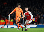 Arsenal's Shkodran Mustafi tussles with Liverpool's Roberto Firmino during the premier league match at the Emirates Stadium, London. Picture date 22nd December 2017. Picture credit should read: David Klein/Sportimage