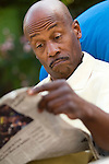 Man reading newspaper with surprise