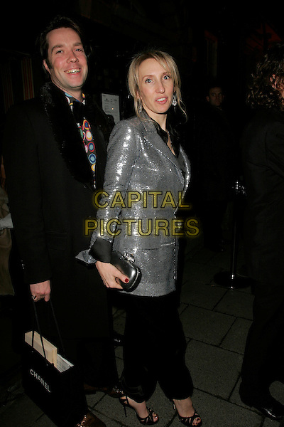 GUEST & SAM TAYLOR WOOD.The Finch & Partners' Chanel Pre-BAFTA Party held at Annabel's, London, England..February 7th, 2009.full length black trousers silver dress top clutch bag suit .CAP/AH.©Adam Houghton/Capital Pictures.