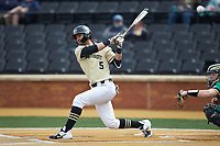 Patrick Frick (5) of the Wake Forest Demon Deacons follows through on his swing against the Notre Dame Fighting Irish at David F. Couch Ballpark on March 10, 2019 in  Winston-Salem, North Carolina. The Demon Deacons defeated the Fighting Irish 7-4 in game one of a double-header.  (Brian Westerholt/Four Seam Images)