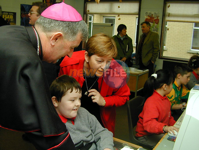 Niall Dooley shows Bishop Smith how it's Done on the new computer system in St Pauls watched by Mary Lynch.Picture by Fran Caffrey Newsfile
