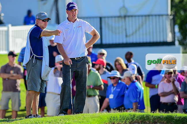 Tom Hoge (USA) and his caddie discuss his pitch on to 9 during the round 2 of the Dean &amp; Deluca Invitational,  Colonial Country Club, Ft. Worth, Texas, USA. 5/27/2016.<br /> Picture: Golffile | Ken Murray<br /> <br /> <br /> All photo usage must carry mandatory copyright credit (&copy; Golffile | Ken Murray)
