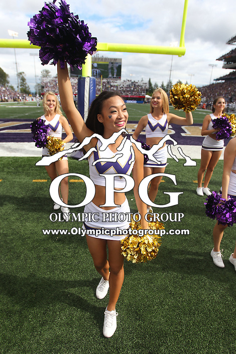 SEP 19, 2015:  University of Washington's cheerleader Julia Tran cheers against Utah State.  Washington defeated Utah State 31-17 at Husky Stadium in Seattle Washington.