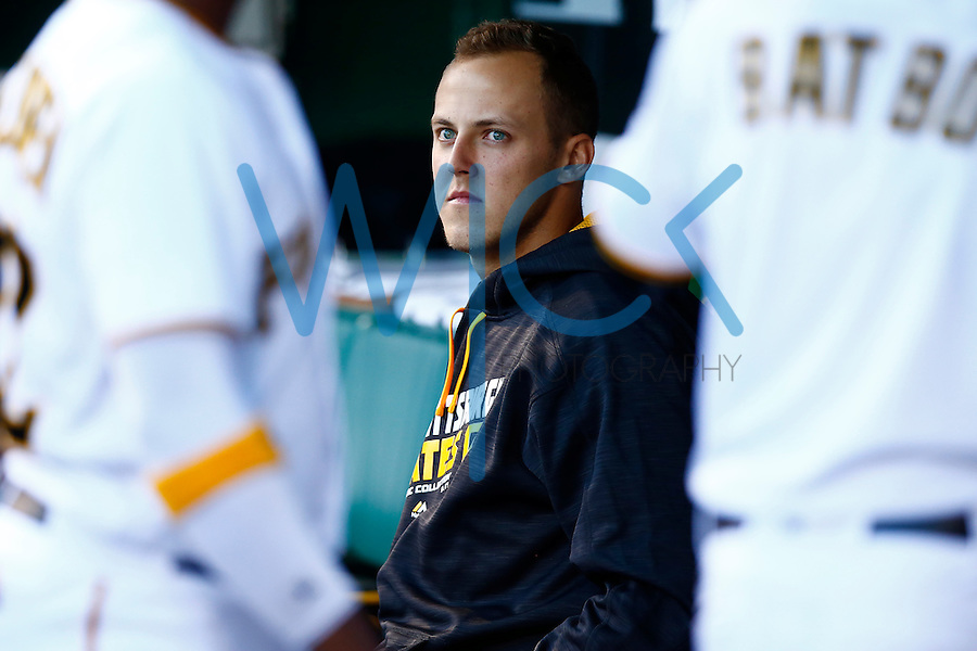 Jameson Taillon #50 of the Pittsburgh Pirates looks on from the dugout against the New York Mets during the game at PNC Park in Pittsburgh, Pennsylvania on June 8, 2016. (Photo by Jared Wickerham / DKPS)