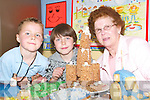 Cakes galore: Taking a peep at some of the home made cakes donated to the fair in the St Mary's Boy's School in Abbeyfeale on Friday were Eoin Morris, Kieran O'Rourke and Eileen Harnett.   Copyright Kerry's Eye 2008