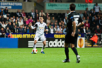 Thursday  03 October  2013  Pictured:Leon Britton ( with ball ) prepares to ke on tMatias Vitkieviez<br /> Re:UEFA Europa League, Swansea City FC vs FC St.Gallen,  at the Liberty Staduim Swansea