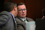 Nevada Sen. Ben Kieckhefer, R-Reno, right, talks with fiscal analyst Russell Guindon at the Legislative Building in Carson City, Nev., on Tuesday, March 31, 2015. <br /> Photo by Cathleen Allison