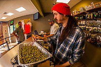 "Weighing pot at the retail ""recreational"" counter before bagging.  Medicine Man Denver is the single largest legal medical and recreational marijuana dispensary in Denver, Colorado USA. Their 20,000 sq. ft. facility will soon double in size. Radio frequency ID tags and 65 video cameras allow the State of Colorado to track inventory through the growing process and all plant weight is accounted for. Medicine Man won the High Times' Cannabis Cup for best sativa (Jack Herer). 20-30 strains are available for sale daily."