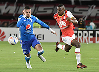 BOGOTÁ - COLOMBIA, 17-12-2017: Dairon Mosquera (Der.) jugador de Santa Fe disputa el balón con Ayron del Valle (Izq.) jugador del Millonarios durante el encuentro entre Independiente Santa Fe y Millonarios por la final vuelta de la Liga Aguila II 2017 jugado en el estadio Nemesio Camacho El Campin de la ciudad de Bogotá. / Dairon Mosquera (R) player of Santa Fe struggles for the ball with Ayron del Valle (L) player of Millonarios during match between Independiente Santa Fe and Millonarios for the second leg final of the Aguila League II 2017 played at the Nemesio Camacho El Campin Stadium in Bogota city. Photo: VizzorImage/ Gabriel Aponte / Staff