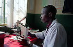 The laboratory technician analysing some samples at the health centre of Kivuye, district of Burera, Rwanda