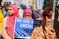 Muslims from the tri-state area gather on Madison Avenue  in New York on Sunday, September 25, 2016 for the American Muslim Parade. The annual parade, now in it's 31st year, celebrates the diversity and heritage of Islamic culture. Participants march down Madison Avenue ending in a street fair. (© Richard B. Levine)