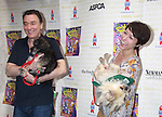 """Patrick Page & Paige Davis attend Broadway Barks Lucky 13th Annual Adopt-a-thon - A """"Pawpular"""" Star-studded dog and cat adopt-a-thon on July 9, 2011 in Shubert Alley, New York City, New York with Bernadette Peters and Mary Tyler Moore as hosts.  (Photo by Sue Coflin/Max Photos)"""