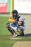 Princeton Rays catcher Nick Ciuffo (14) warms up his starting pitcher in the bullpen prior to the game against the Burlington Royals at Burlington Athletic Park on July 11, 2014 in Burlington, North Carolina.  The Rays defeated the Royals 5-3.  (Brian Westerholt/Four Seam Images)