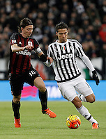 Calcio, Serie A: Juventus vs Milan. Torino, Juventus Stadium, 21 novembre 2015. <br /> Juventus Hernanes, right, is challenged by AC Milan&rsquo;s Riccardo Montolivo during the Italian Serie A football match between Juventus and AC Milan at Turin's Juventus stadium, 21 November 2015. Juventus won 1-0.<br /> UPDATE IMAGES PRESS/Isabella Bonotto