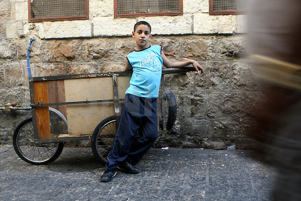 Portrait of Ayuob, an 11 year-old Palestinian boy who works in one of the markets in east Jerusalem's old city. July 20, 2008. .Photo by : Tess Scheflan/ JINI