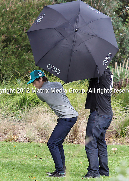 8th April, 2012  Sydney, Australia..NON EXCLUSIVE ..Zac Effron enjoys shows off his crap golfing style at Moore Park Golf Club with a friend. Zac was bemused by the presence of photographers and devised an ingenious umbrella in the pocket device to shield himself while swinging at the 8th tee. Zac took a shot right over the heads of photogs hiding in the bushes.