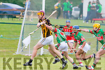 Abbeydorney forward Michael O'Leary goes to strike as 3 Crotta players close in on him