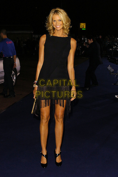 ELLE MACPHERSON.At the Giorgio Armani RED One Night Only .Fashion & Music Party, Earls Court, .London, England, September 21st 2006..full length black dress fringed tassles tanned.Ref: CAN.www.capitalpictures.com.sales@capitalpictures.com.©Can Nguyen/Capital Pictures