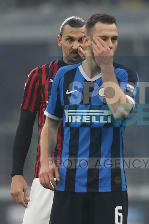 Stefan de Vrij of Inter and Zlatan Ibrahimovic of AC Milan during the Serie A match at Giuseppe Meazza, Milan. Picture date: 9th February 2020. Picture credit should read: Jonathan Moscrop/Sportimage
