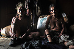 Penan elderly couple, the man still wears the old style chawat loincloths. They where nomadic a few decades ago. The Penan native people are learning to live a sedentary lifestyle which includes living in wooden houses, farming and fishing. They were traditionally nomadic hunter-gatherers. These days they have become forcibly settled as their hunting grounds have been largely destroyed by logging concessions and palm-oil plantations. Long Napir, Limbang, Sarawak Malaysia 2015<br />