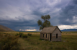 Idaho, Southeast, Montpelier, Bear Lake. An old cabin under stormy autumn skies.