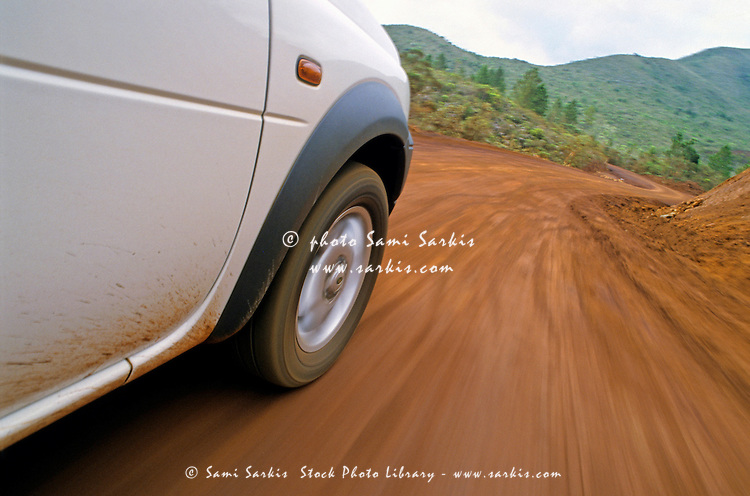 New Caledonia, Grand Terre Island, car on road (blurred motion)