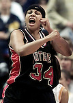(NCAA WOMENS FINAL FOUR SEMI FINALS)--On Fri Mar 31,2000---RUTGERS # 34 Shawnetta Stewart lets out a scream after driving to the basket and scoring in the opening moments of the 2nd half of play at the First Union Center in Phila. , PA.(MARK R. SULLIVAN)