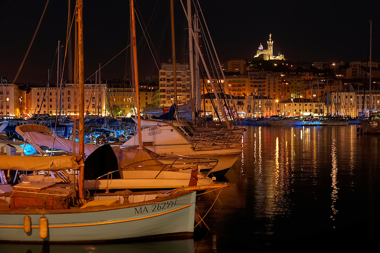 Night time illumination creates a soft, magical effect in the Old Port of Marseille.