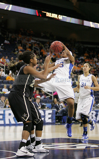 UK guard Bria Goss attempts a shot during the first half of the University of Kentucky women's basketball game vs. Vanderbilt University during the SEC tournament The Arena at Gwinnett Center in Duluth, Ga. on Friday, March 8, 2013. UK won 76-65. Photo by Genevieve Adams | Staff