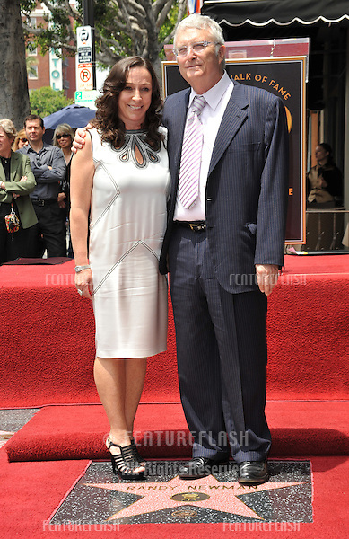 Composer Randy Newman & wife Gretchen Preece on Hollywood Boulevard where Newman was honored today with a star on the Hollywood Walk of Fame..June 2, 2010  Los Angeles, CA.Picture: Paul Smith / Featureflash