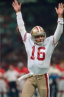 NEW ORLEANS, LA - Quarterback Joe Montana of the San Francisco 49ers signals for a touchdown during Super Bowl XXIV against the Denver Broncos at the Superdome in New Orleans, Louisiana in January of 1990. Photo by Brad Mangin