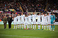 Swansea City players observe a minute's silence prior to the Premier League match between Swansea City and Manchester United at The Liberty Stadium, Swansea, Wales, UK. Sunday 06 November 2016