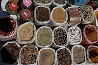 The weekly Friday market at Mapusa in the Indian state of Goa attracts large crowds from roundabout who come to buy their provisions for the week. These roots, powders and spices, on sale at a stall in the market, are essential elements in Indian recipes.