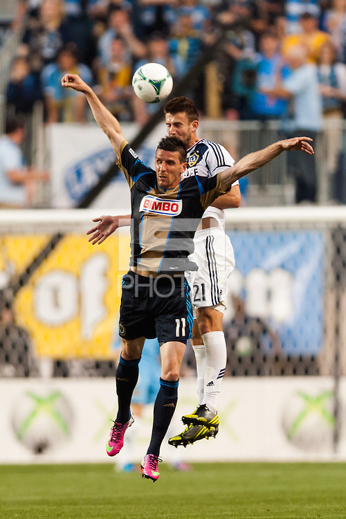 Sebastien Le Toux (11) of the Philadelphia Union goes up for a header with Tommy Meyer (21) of the Los Angeles Galaxy. The Los Angeles Galaxy defeated the Philadelphia Union 4-1 during a Major League Soccer (MLS) match at PPL Park in Chester, PA, on May 15, 2013.