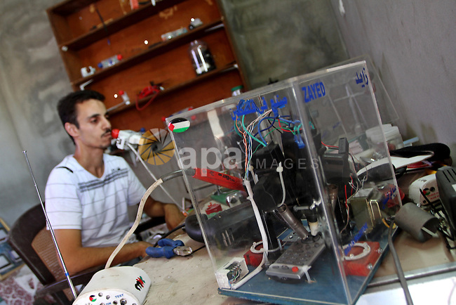 Monzer al-Qasas, a Palestinian inventor who works on electronic machine for the disabled, is seen at his home in Gaza City, on August 31, 2010. The 30-year-old man invents electronic machines to help the disabled who have quadriplegia to operate television and computer by using their heads and tongues . Photo by Ashraf Amra