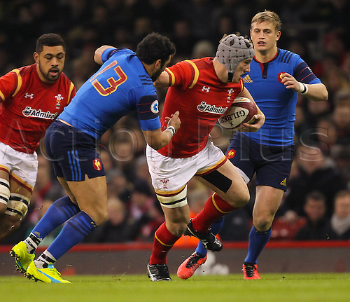 26.02.2016. Principality Stadium, Cardiff, Wales. RBS Six Nations Championships. Wales versus France. Wales Jonathan Davies holds off the tackle from France's Maxime Mermoz