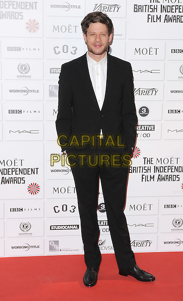 James Norton.14th Moet British Independent Film Awards 2011, Old Billingsgate, Lower Thames Street, London, England, 4th December 2011.full length black suit white shirt beard facial hair hands in pockets .CAP/BEL.©Tom Belcher/Capital Pictures.