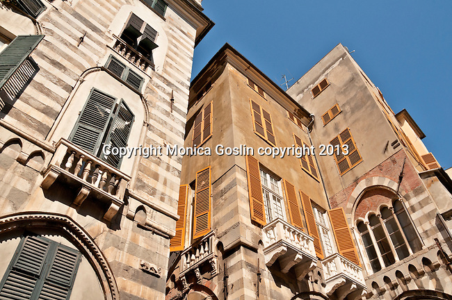 Looking up at colorful houses and balconies with a mixture of Medieval and Baroque architecture