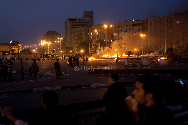 Protesters return to the grassy roundabout on Tahrir Square, after the Egyptian army and Central Security Forces tried to clear the square of protesters on Sunday, Nov. 20, 2011. Soldiers burned down protesters tents and beat people with clubs, but a short time later, the demonstrators returned.