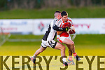 Flor McAulliffe Brosna is tackled by Glin Tommy culhane during the Munster junior final in mallow on Sunday